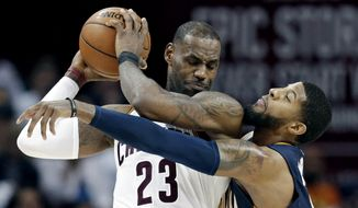 Indiana Pacers' Paul George, right, reaches in against Cleveland Cavaliers' LeBron James in the second half in Game 2 of a first-round NBA basketball playoff series, Monday, April 17, 2017, in Cleveland. The Cavaliers won 117-111. (AP Photo/Tony Dejak)