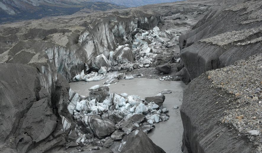 In this photo provided by Jim Best/University of Illinois, taken in 2016, a close-up view of the ice-walled canyon at the terminus of the Kaskawulsh Glacier, with recently collapsed ice blocks. This canyon now carries almost all meltwater from the toe of the glacier down the Kaskawulsh Valley and toward the Gulf of Alaska and the Pacific Ocean instead of the Bering Sea. (Jim Best/University of Illinois via AP)