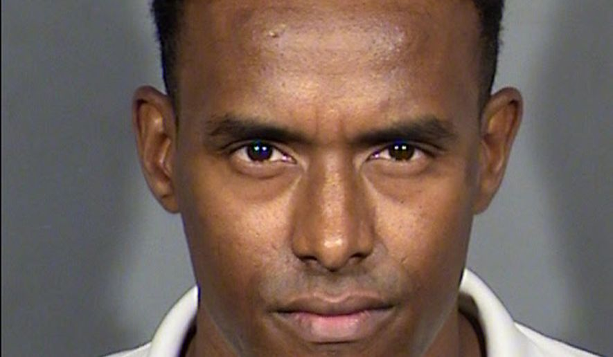This Saturday, April 15, 2017, law enforcement booking photo provided the Las Vegas Metropolitan Police Department shows Neb Solomon. Solomon, a journalist who was reporting at a Tax Day protest at President Donald Trump's signature Las Vegas hotel, the Trump International, was arrested by police during the demonstration. KLAS Vice President and General Manager Lisa Howfield said Solomon was freed Saturday night, hours after he was arrested while covering the off-Strip protest. (Las Vegas Metropolitan Police Department via AP)
