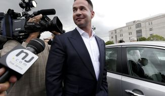 """FILE - In this Sept. 24, 2014, file photo, reporters gather around Michael """"The Situation"""" Sorrentino as he leaves the MLK Jr. Federal Courthouse in Newark, N.J., after a court appearance. Michael Sorrentino and his brother Marc Sorrentino are set to appear in court to face additional tax fraud charges are scheduled to be arraigned on Monday, April 17, 2017, in federal court in Newark. They previously pleaded not guilty to charges they filed bogus tax returns on nearly $9 million and claimed millions in personal expenses as business expenses. (AP Photo/Julio Cortez, File)"""