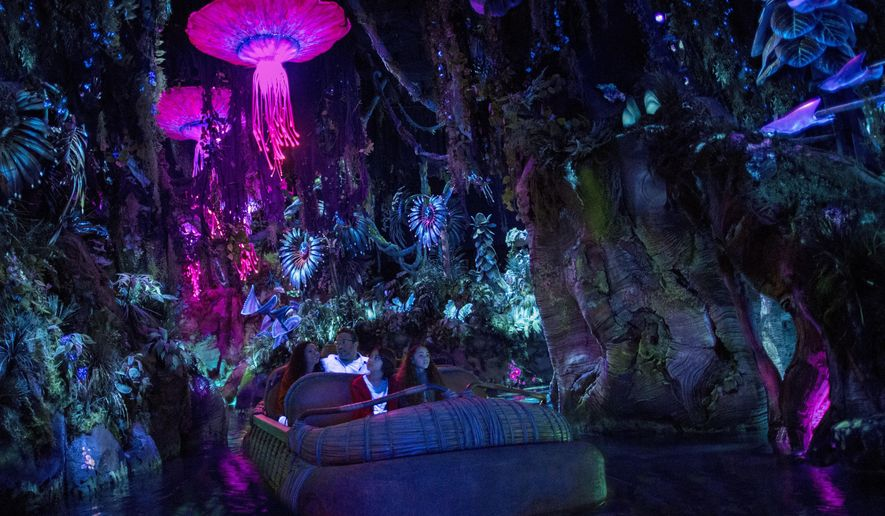 """This photo provided by Disney shows guests in the """"Na'vi River Journey,"""" part of the new land opening at Walt Disney World's Animal Kingdom in Lake Buena Vista, Fla., on May 27, 2017, called """"Pandora - The World of Avatar."""" The land was inspired by the lush world of Pandora depicted in the movie """"Avatar."""" (Disney via AP)"""
