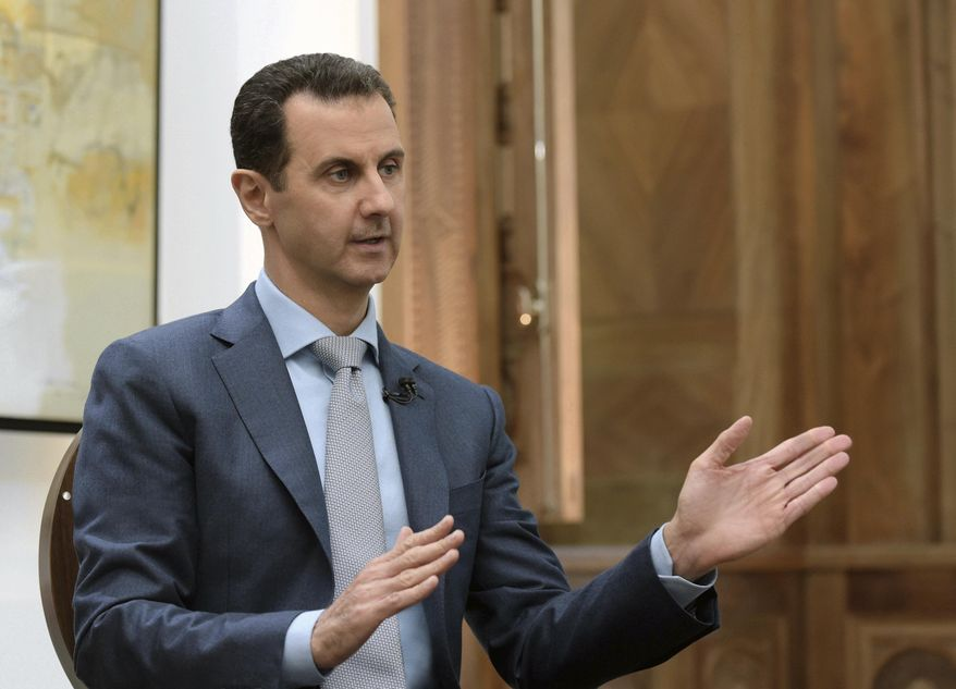 In this Feb. 10, 2017, file photo released by the Syrian official news agency SANA, Syrian President Bashar Assad speaks during an interview with Yahoo News in Damascus, Syria. (SANA via AP, File)