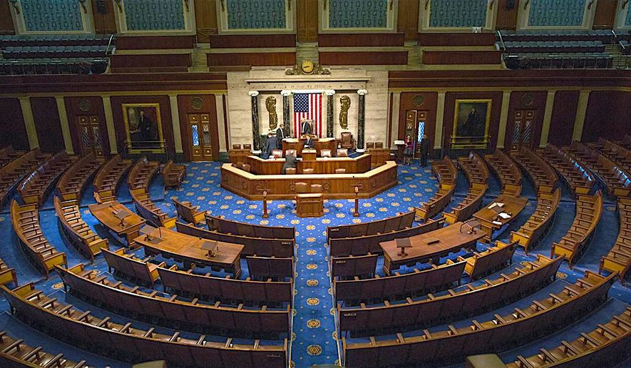 Associated Press   An empty U.S. House chamber stands waiting for its occupants.