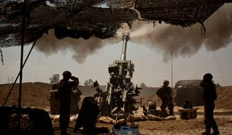 U.S. soldiers from the 82nd Airborne Division fire artillery in support of Iraqi forces fighting Islamic State militants from their base east of Mosul on Monday. (Associated Press)