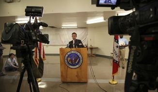 Arkansas governor spokesman J.R. Davis speaks after the news that the U.S. Supreme Court stayed the scheduled Monday, April 17, 2017, execution of Don Davis, scuttling efforts to resume capital punishment after nearly 12 years, in Varner, Ark. (AP Photo/John L. Mone)