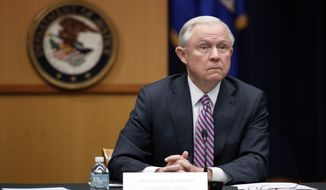 Attorney General Jeff Sessions listens to reporter's question before a meeting of the Attorney General's Organized Crime Council and Organized Crime Drug Enforcement Task Forces (OCDETF) Executive Committee to discuss implementation of the President's Executive Order 13773, Tuesday, April 18, 2017, at the Justice Department in Washington. (AP Photo/Alex Brandon)