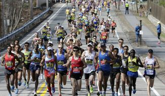 Elite men runners lead the field in the 121st Boston Marathon on Monday, April 17, 2017, in Hopkinton, Mass. (AP Photo/Steven Senne)