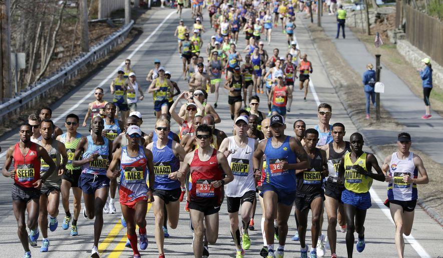 Elite men runners lead the field in the 121st Boston Marathon on Monday, April 17, 2017, in Hopkinton, Mass. (AP Photo/Steven Senne)