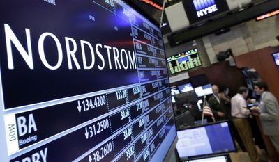 In this May 13, 2016, file photo, the Nordstrom logo is displayed above the post where it trades on the floor of the New York Stock Exchange in New York. (AP Photo/Richard Drew, File)