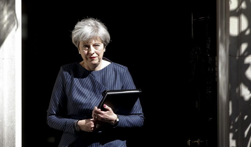 Britain's Prime Minister Theresa May walks out of 10 Downing Street to speak to the media in London, Tuesday April 18, 2017. British Prime Minister Theresa May announced she will seek early election on June 8 (AP Photo/Alastair Grant)