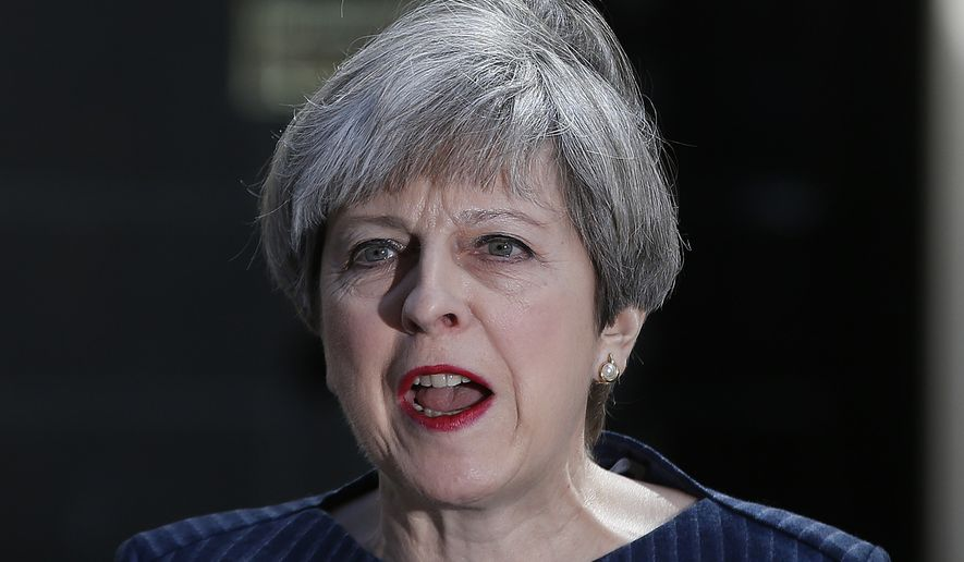 Britain's Prime Minister Theresa May speaks to the media outside her official residence of 10 Downing Street in London, Tuesday April 18, 2017. British Prime Minister Theresa May announced she will seek early election on June 8 (AP Photo/Alastair Grant)