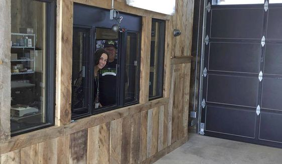 Misty Garcia mans the drive up window at the Tumbleweed Express Drive-Thru Monday, April 17, 2017, in Parachute, Colo. Customers will be able to start pulling their cars into the Tumbleweed Express Drive-Thru starting Thursday, April 20. The business is believed to be Colorado's first drive-thru marijuana shop. (Alex Zorn/Glenwood Springs Post Independent via AP)