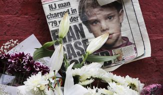 FILE - This May 28, 2012, file photo shows a newspaper with a photograph of Etan Patz at a makeshift memorial in the SoHo neighborhood of New York where Patz lived before his disappearance on May 25, 1979. Pedro Hernandez, the man convicted of killing Patz, is set to learn his punishment in one of America's most notorious missing-child cases on Tuesday, April 18, 2017. (AP Photo/Mark Lennihan, File)