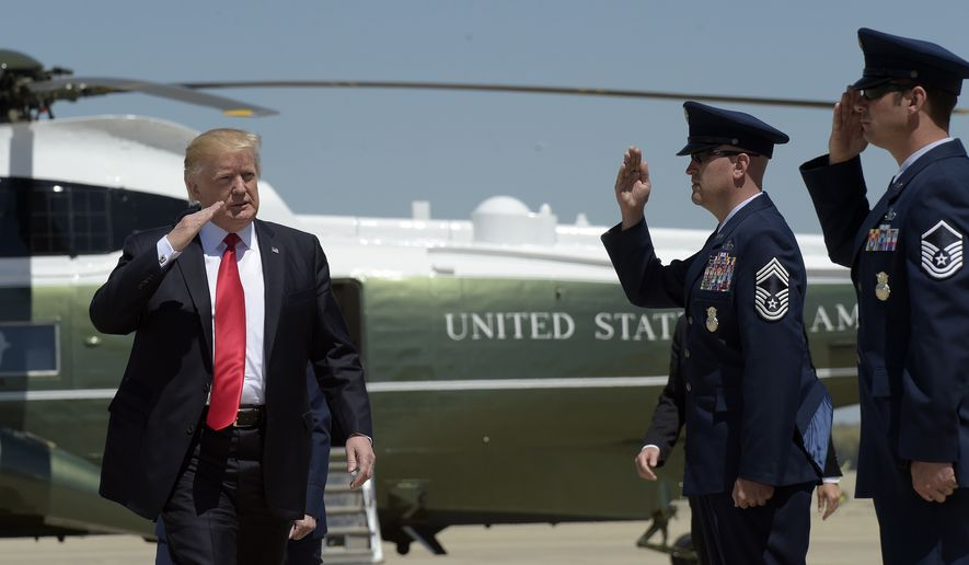 President Donald Trump salutes before boarding Air Force One at Andrews Air Force Base in Md., Tuesday, April 18, 2017. Trump is heading to Kenosha, Wis., to visit the headquarters of tool manufacturer Snap-on Inc., and sign a an executive order that seeks to make changes to a visa program that brings in high-skilled workers. (AP Photo/Susan Walsh)