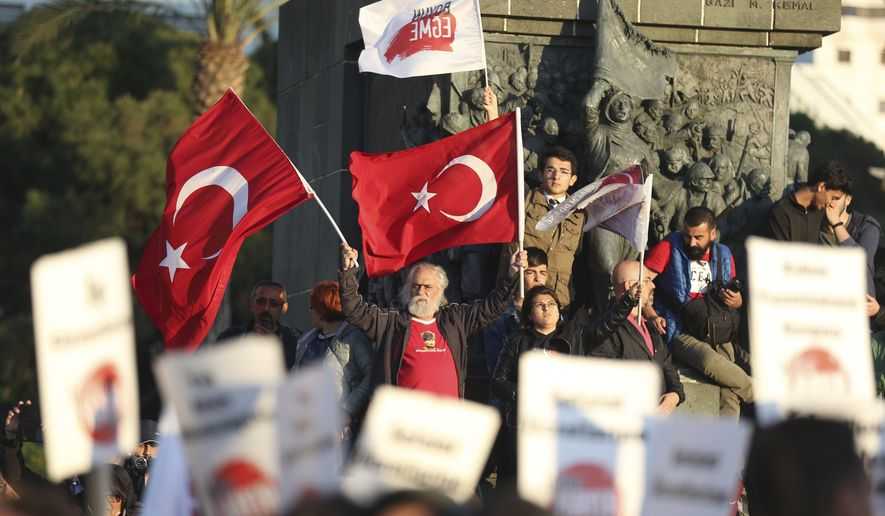 Supporters of the 'no' vote, chant slogans during a protest against the referendum outcome, on the Aegean Sea city of Izmir, Turkey, Tuesday, April 18, 2017. Turkey's main opposition party has filed a formal request seeking Sunday's referendum to be annulled because of voting irregularities. (AP Photo/Emre Tazegul)
