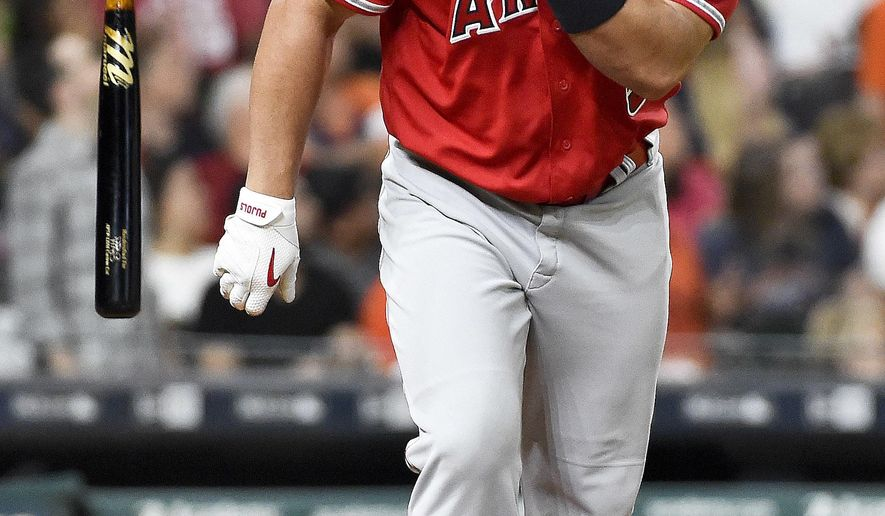 Los Angeles Angels' Albert Pujols throws his bat after hitting a three-run home run off Houston Astros starting pitcher Joe Musgrove in the fifth inning of a baseball game, Tuesday, April 18, 2017, in Houston. (AP Photo/Eric Christian Smith)