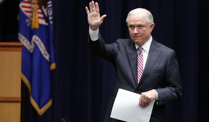 Attorney General Jeff Sessions waves as he arrives for a meeting of the Attorney General's Organized Crime Council and Organized Crime Drug Enforcement Task Forces (OCDETF) Executive Committee to discuss implementation of the President's Executive Order 13773, Tuesday, April 18, 2017, at the Justice Department in Washington. (AP Photo/Alex Brandon)