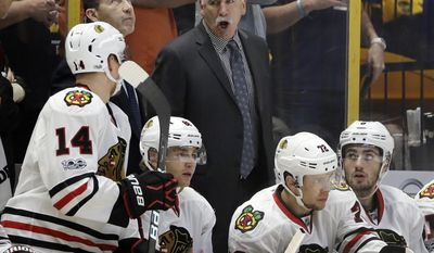 Chicago Blackhawks head coach Joel Quenneville talks to left wing Richard Panik (14), of Slovakia, during the first period in Game 3 of a first-round NHL hockey playoff series against the Nashville Predators, Monday, April 17, 2017, in Nashville, Tenn. (AP Photo/Mark Humphrey)