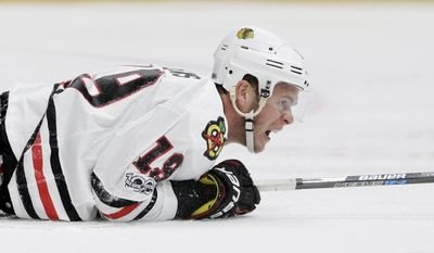 Chicago Blackhawks center Jonathan Toews yells after a collision during the third period in Game 3 of a first-round NHL hockey playoff series against the Nashville Predators Monday, April 17, 2017, in Nashville, Tenn. (AP Photo/Mark Humphrey)