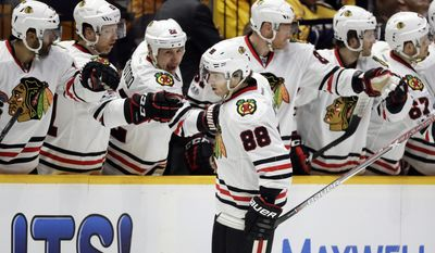 Chicago Blackhawks right wing Patrick Kane (88) is congratulated after scoring a goal against the Nashville Predators during the second period in Game 3 of a first-round NHL hockey playoff series, Monday, April 17, 2017, in Nashville, Tenn. (AP Photo/Mark Humphrey)