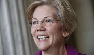 """FILE - In this Feb. 8, 2017 file photo, U.S. Sen. Elizabeth Warren, D-Mass. is seen on Capitol Hill in Washington. She wasn't in her home state, but Warren couldn't have asked for a friendlier audience to launch her book tour. The Massachusetts Democrat entered and left to warm ovations Tuesday night, April 18, 2017, at the Barnes & Noble in Manhattan's Union Square, where she spoke about """"This Fight is Our Fight: The Battle to Save America's Middle Class."""" (AP Photo/J. Scott Applewhite, File)"""