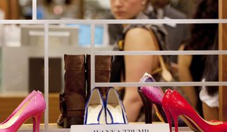 FILE - In this Aug. 23, 2012, file photo, shoes from the Ivanka Trump collection are displayed at a Lord & Taylor department store in New York. Retailers are trying to figure out a way to deal with the politically charged Ivanka Trump brand, stamped on everything from shoes to pants to handbags. The products have become more polarized with President Donald Trump's rise to The White House, and retailers are trying to be careful not to offend shoppers from both sides of the political aisle. (AP Photo/Mark Lennihan, File)