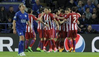 Atletico Madrid's Saul Niguez, obscured, celebrates scoring his side's first goal during the Champions League quarterfinal second leg soccer match between Leicester City and Atletico Madrid at King Power Stadium, Leicester, England, Tuesday, April 18, 2017. (AP Photo/Rui Vieira)