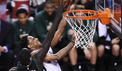 FILE - This April 15, 2017 file photo shows Toronto Raptors guard DeMar DeRozan (10) being blocked by Milwaukee Bucks forward Thon Maker (7) during second-half NBA playoff basketball game action in Toronto. Maker hopes to throw another block party when Milwaukee visits the Toronto Raptors in Game 2 of a first-round NBA playoff series. The 7-foot-1 Maker had three blocks against the Raptors, two early in the third quarter to help spark a defensive resurgence for Milwaukee. Maker's first career playoff came in familiar surroundings. He spent two years playing at an academy about 50 miles north of Toronto before being drafted by Milwaukee with the 10th overall pick in June. (Nathan Denette/The Canadian Press via AP)