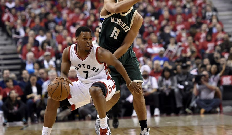 Toronto Raptors guard Kyle Lowry (7) looks to pass under pressure from Milwaukee Bucks guard Malcolm Brogdon (13) during the first half of Game 2 of an NBA basketball first-round playoff series, Tuesday, April 18, 2017, in Toronto. (Nathan Denette/The Canadian Press via AP)