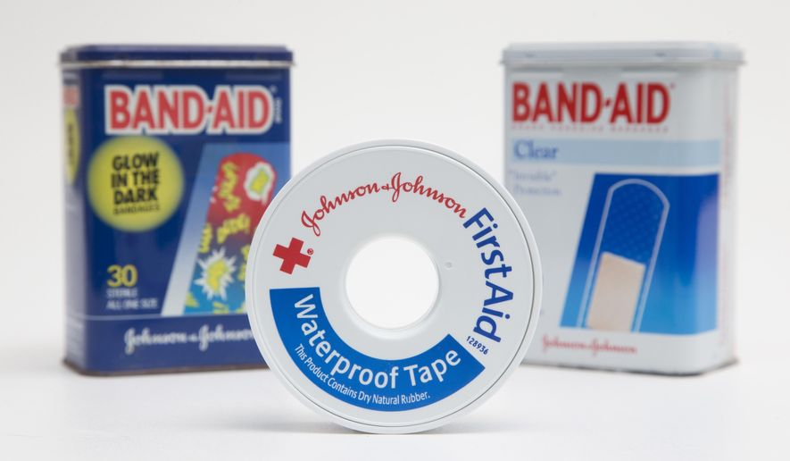 In this Tuesday, Sept. 13, 2016, photo, a selection of Johnson & Johnson brand first aid products are shown in Surfside, Fla. Johnson & Johnson reports financial earnings Tuesday, April 18, 2017. (AP Photo/Wilfredo Lee)