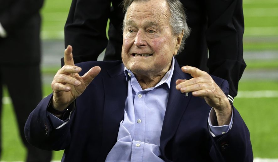"""FILE - In this Feb. 5, 2017, file photo, former President George H.W. Bush arrives on the field for a coin toss before the NFL Super Bowl 51 football game between the Atlanta Falcons and the New England Patriots in Houston. Bush has been hospitalized in Houston since last Friday, Aprul 14, 2017,  with a recurrence of a case of pneumonia he had earlier in the year. Bush spokesman Jim McGrath said in a statement Tuesday, April 18, 2017, doctors determined he had a mild case of pneumonia which has been treated and resolved. McGrath said the former president """"is in very good spirits and is being held for further observation while he regains his strength."""" (AP Photo/Eric Gay, File)"""