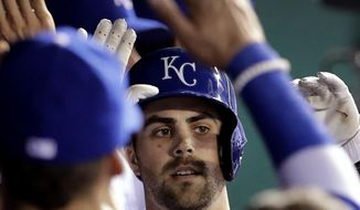Kansas City Royals' Whit Merrifield celebrates in the dugout after hitting a solo home run during the fifth inning of the team's baseball game against the San Francisco Giants on Tuesday, April 18, 2017, in Kansas City, Mo. (AP Photo/Charlie Riedel)