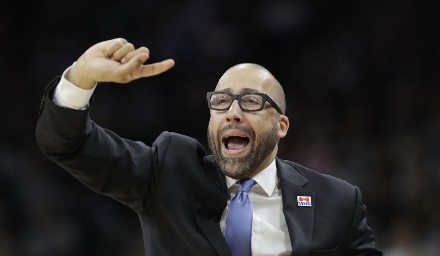 Memphis Grizzlies head coach David Fizdale signals to his players during the first half in Game 2 of a first-round NBA basketball playoff series against the San Antonio Spurs, Monday, April 17, 2017, in San Antonio. (AP Photo/Eric Gay)