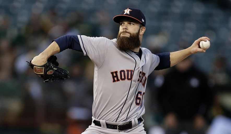 FILE - In this Friday, April 14, 2017, file photo, Houston Astros pitcher Dallas Keuchel works against the Oakland Athletics during the first inning of a baseball game in Oakland, Calif. After struggling to defend his 2015 AL Cy Young Award last season, Keuchel is back in ace form for Houston. (AP Photo/Ben Margot, File)