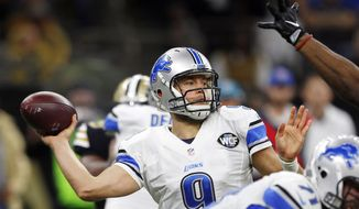 "FILE - In this Dec. 4, 2016, file photo, Detroit Lions quarterback Matthew Stafford (9) throws a touchdown pass to wide receiver Golden Tate, not pictured, in the second half of an NFL football game in New Orleans. Stafford is in line to sign a contract extension that will set up his newborn twins for life. The quarterback hopes ""his people,"" and the Detroit Lions' ""people,"" can agree on a deal that's good for him and the team. Stafford is entering the last season of his $53 million, three-year contract and might be able to get more than the $140 million, six-year deal Andrew Luck signed last year with the Indianapolis Colts. (AP Photo/Butch Dill, File)"