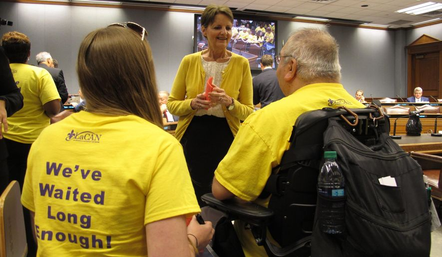 Sandee Winchell, executive director of the Louisiana Developmental Disabilities Council, speaks to members of the public who were asking the House Appropriations Committee to steer more money to services for people with disabilities, on Tuesday, April 18, 2017, in Baton Rouge, La. (AP Photo/Melinda Deslatte)