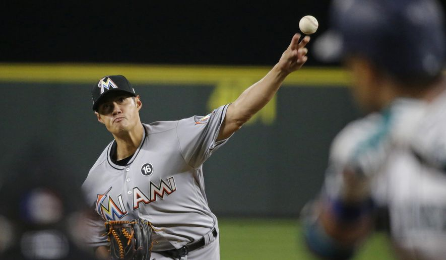 Miami Marlins' Wei-Yin Chen pitches to Seattle Mariners' Robinson Cano during the fourth inning of a baseball game, Tuesday, April 18, 2017, in Seattle. (AP Photo/Ted S. Warren)