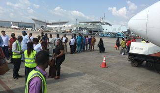 FILE- In this Saturday, Oct. 15, 2016, file photo, passengers are searched before boarding a flight at the Nnamdi Azikiwe International Airport in Abuja. Nigeria's government says the international airport in its capital is reopening after six weeks of repairs to the runway, which experts had said was in shocking disrepair. Nigeria says the Abuja airport is opening Tuesday April.18, 2017 a day ahead of schedule. (AP Photo/Sunday Alamba, File)