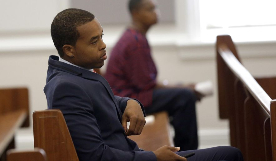 Former North Carolina Central football player Michael Johnson listens at the Orange County Courthouse in Hillsborough, N.C., Monday, April 17, 2017. Johnson was one of five people facing charges in the North Carolina sports agents case. (AP Photo/Gerry Broome)