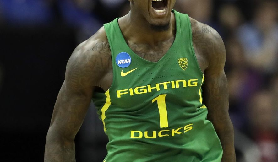 FILE--In this March 25, 2017, file photo, Oregon's Jordan Bell reacts during an NCAA men's college basketball tournament Midwest Regional championship game against Kansas in Kansas City, Mo. Bell has become the latest Ducks player to declare for the NBA draft. (AP Photo/Charlie Riedel, file)