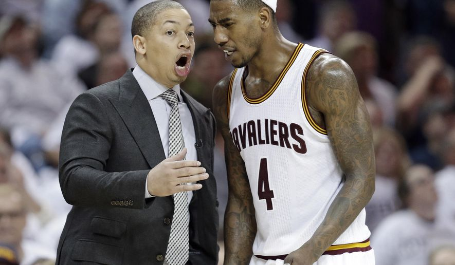 Cleveland Cavaliers head coach Tyronn Lue talks with Iman Shumpert in the second half in Game 2 of a first-round NBA basketball playoff series, Monday, April 17, 2017, in Cleveland. The Cavaliers won 117-111. (AP Photo/Tony Dejak)