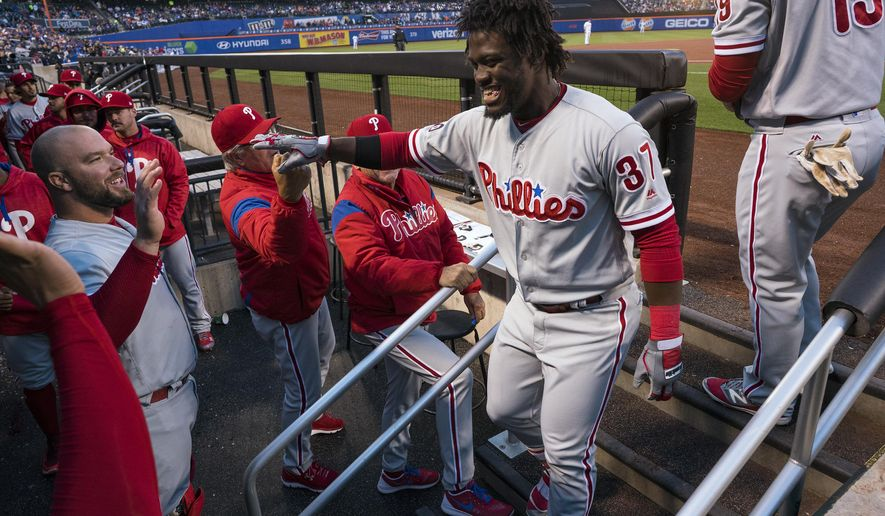 Philadelphia Phillies' Odubel Herrera returns to the dugout after a first-inning solo home run during a baseball game against the New York Mets on Tuesday, April 18, 2017, in New York. (AP Photo/Craig Ruttle)