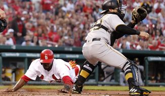St. Louis Cardinals' Dexter Fowler, left, scores past Pittsburgh Pirates catcher Francisco Cervelli during the first inning of a baseball game Tuesday, April 18, 2017, in St. Louis. (AP Photo/Jeff Roberson)