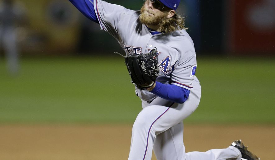 Texas Rangers pitcher A.J. Griffin works against the Oakland Athletics in the sixth inning of a baseball game Monday, April 17, 2017, in Oakland, Calif. (AP Photo/Ben Margot)