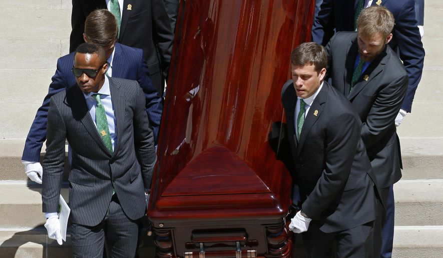 Pallbearers, including former Pittsburgh Steelers Ike Taylor, left front, carry the casket of longtime Pittsburgh Steelers chairman, Pro Football Hall of Famer and former U.S. ambassador to Ireland Dan Rooney, out of St. Paul's Cathedral Tuesday, April 18, 2017. Rooney died Thursday, April 13. He was 84. (AP Photo/Gene J. Puskar)