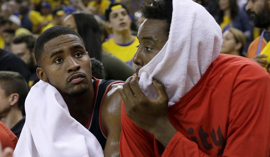 Portland Trail Blazers forward Maurice Harkless, left, and Al-Farouq Aminu sit on the bench during the second half of Game 1 of a first-round NBA basketball playoff series against the Golden State Warriors in Oakland, Calif., Sunday, April 16, 2017. The Warriors won 121-109. (AP Photo/Jeff Chiu)