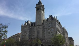 This April 13, 2017 image shows the clock tower at the Old Post Office, a historic building in Washington D.C., where the Trump International Hotel is located. The clock tower is operated by the National Park Service and was recently reopened to the public for tours. (AP Photos/Beth J. Harpaz)