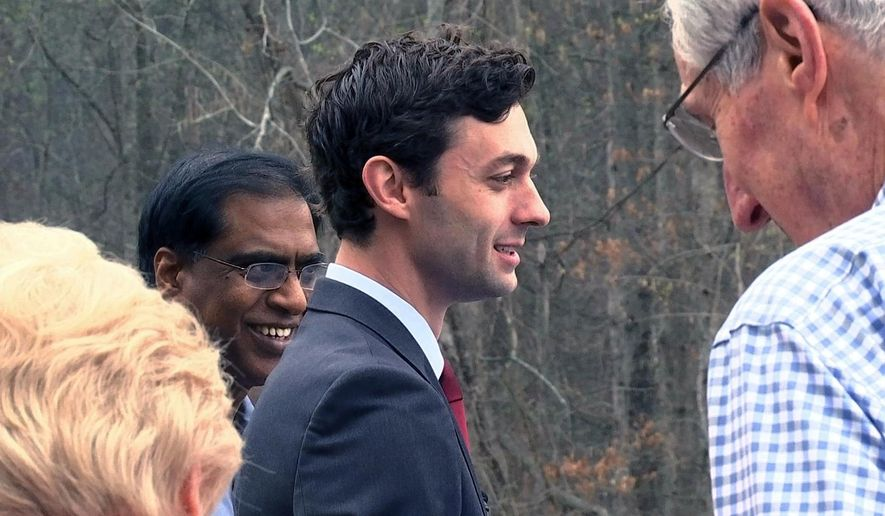 Democratic congressional candidate Jon Ossoff is seen with supporters outside of the East Roswell Branch Library in Roswell, Ga., on the first day of early voting, in this Monday, March 27, 2017, file photo. (AP Photo/Alex Sanz)
