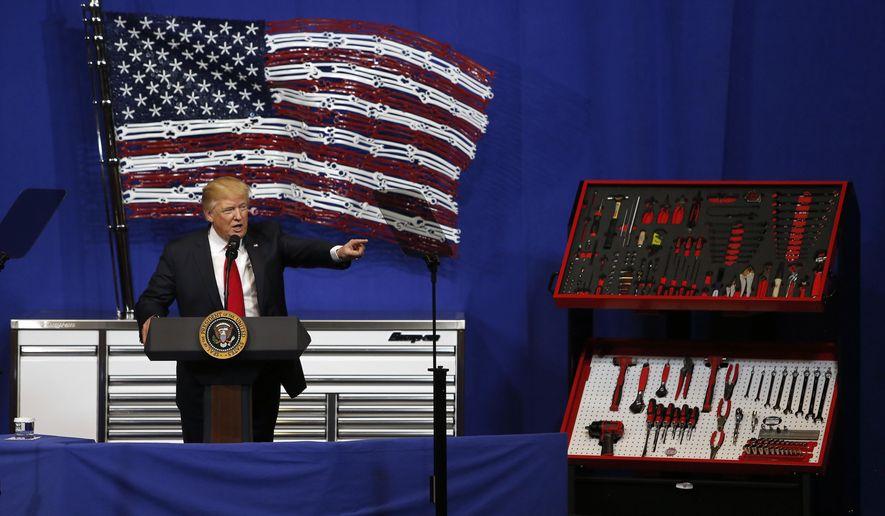 President Donald Trump speaks at Snap-On Tools, Tuesday, April 18, 2017, in Kenosha, Wis. (AP Photo/Kiichiro Sato)