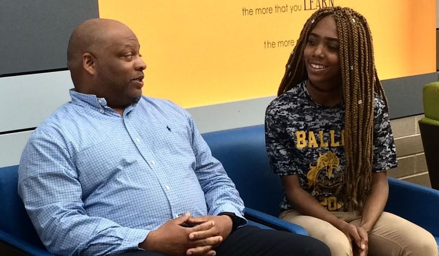 Nelson Greene, Pathways coordinator at Ballou High School, is helping all-star athlete Mikayla Hooks find a clear academic direction so she can continue  her cheerleading career. (Julia Brouillette/The Washington Times)